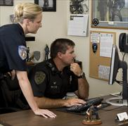 Two Officers At Desk